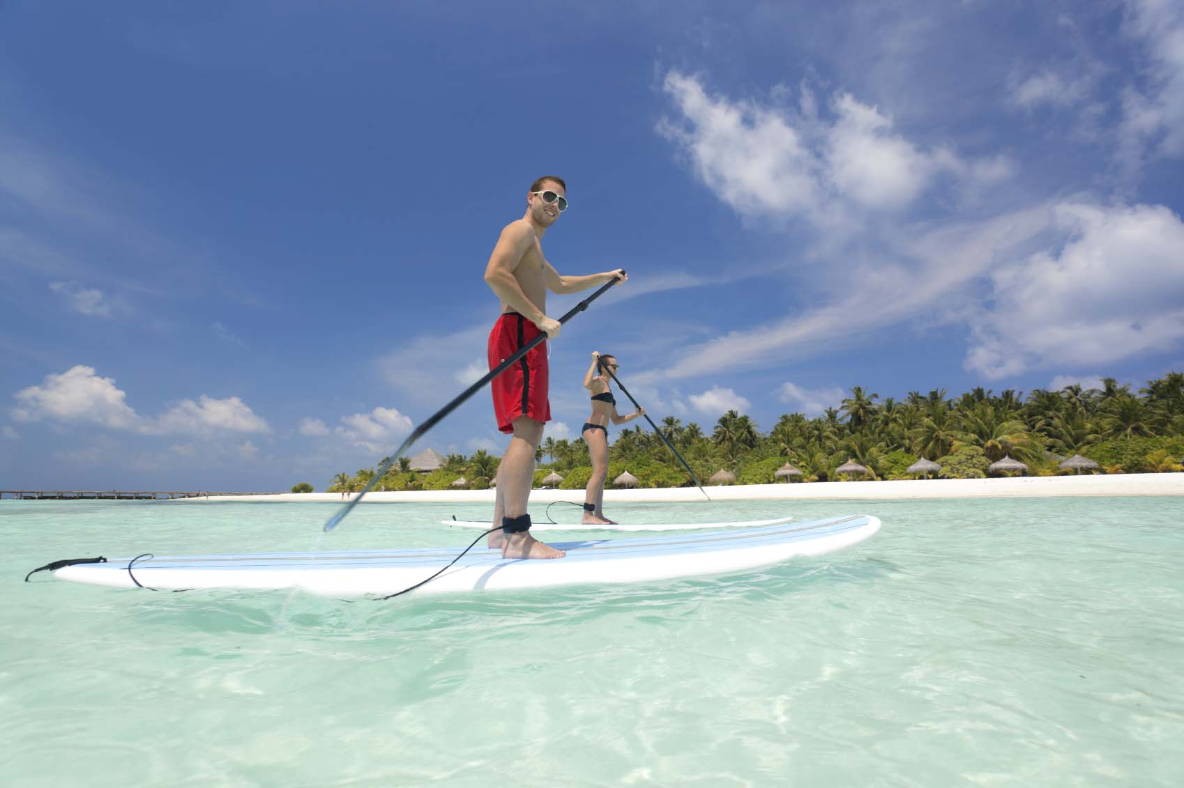 people stand up paddling lagoon